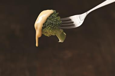 Broccoli dipped in cheese sauce