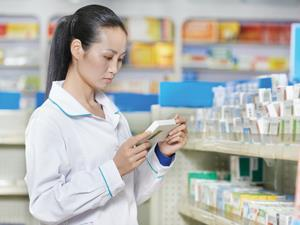 pharmacist with drug package