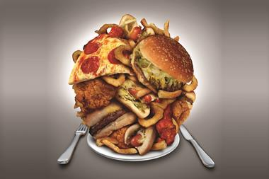 A piled up plate of junk food