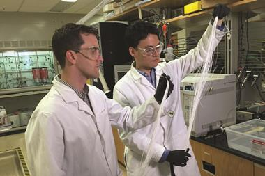 ryan lively and dong yeun koh holding polymer fibers