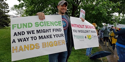 A man holding placards at the March for science, Washington DC